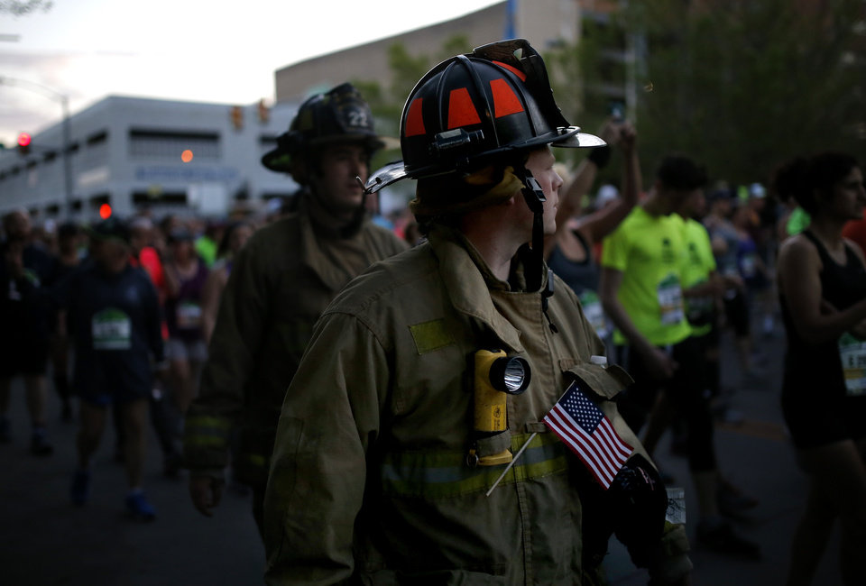 Photo - Firefighter begin to walk the Oklahoma City Marathon in Oklahoma City,  Sunday, April 29, 2018. Photo by Sarah Phipps, The Oklahoman