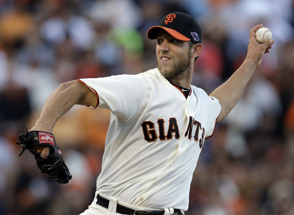Photo -   San Francisco Giants starting pitcher Madison Bumgarner throws during the first inning of Game 1 of baseball's National League championship series against the St. Louis Cardinals Sunday, Oct. 14, 2012, in San Francisco. (AP Photo/David J. Phillip)