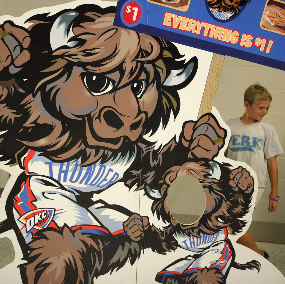 Photo - Cooper Serup, 11, of Edmond walks past a Rumble cutout prior to Game 6 of the Western Conference Finals between the Oklahoma City Thunder and the San Antonio Spurs in the NBA playoffs at the Chesapeake Energy Arena in Oklahoma City, Wednesday, June 6, 2012. Photo by Bryan Terry, The Oklahoman