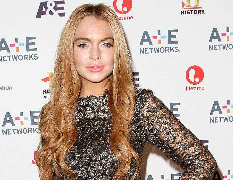 Photo -   In this May 9, 2012 photo shows actress Lindsay Lohan at the A&E Networks 2012 Upfront at Lincoln Center in New York. Lohan will star as Elizabeth Taylor in the upcoming Lifetime TV movie