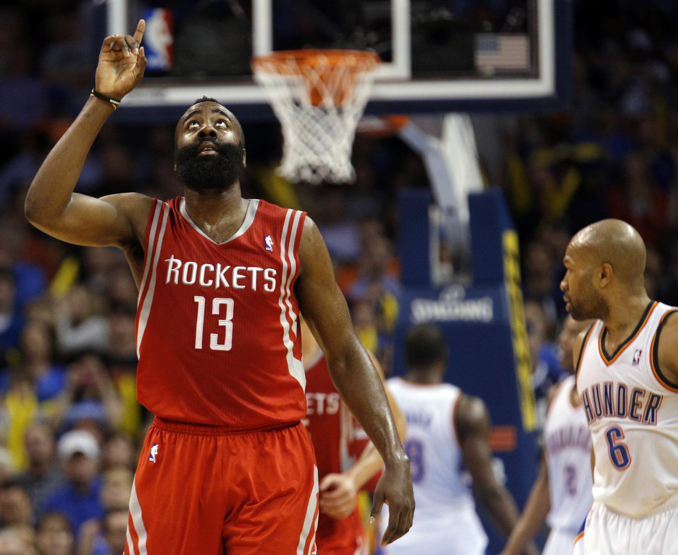 Photo - Houston's James Harden (13) celebrates during the NBA game between the Oklahoma City Thunder and Houston Rockets at the  Chesapeake Energy Arena  in Oklahoma City, Okla., Tuesday, March 11, 2014. Photo by Sarah Phipps, The Oklahoman
