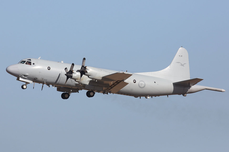 Photo - A Royal Australia Air Force AP-3C Orion leaves the RAAF Pearce Air Base,  Sunday, March 23, 2014 in Perth, Australia, to continue the search for missing Malaysia Airlines Flight MH370. Planes and ships scrambled Sunday to find a pallet and other debris in a remote patch of the southern Indian Ocean to determine whether the objects were from the Malaysia Airlines jet that has been missing for more than two weeks.   (AP Photo/Matt Jelonek, Pool)
