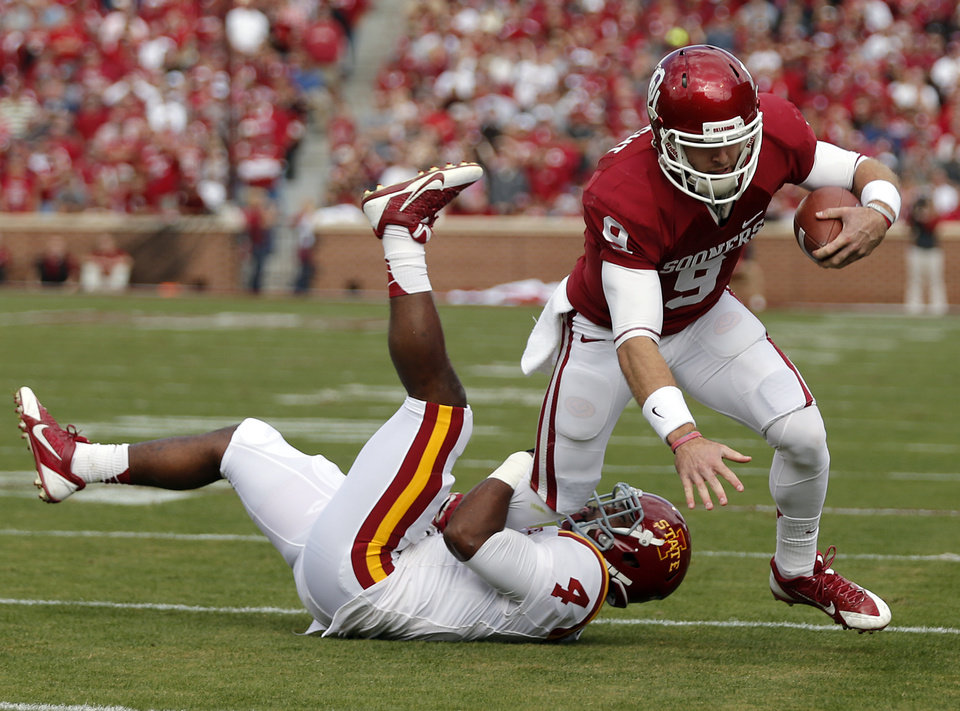 Oklahoma's Trevor Knight (9) runs past Iowa State's Sam E. Richardson (4) during the college football game between the University of Oklahoma Sooners (OU) and the Iowa State University Cyclones (ISU) at Gaylord Family-Oklahoma Memorial Stadium in Norman, Okla. on Saturday, Nov. 16, 2013. Photo by Chris Landsberger, The Oklahoman