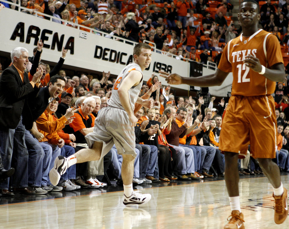 Photo - The crowd reacts after Oklahoma State's Keiton Page (12) made a basket besideTexas' Myck Kabongo (12) during an NCAA college basketball game between Oklahoma State University (OSU) and the University of Texas (UT) at Gallagher-Iba Arena in Stillwater, Okla., Saturday, Feb. 18, 2012. Oklahoma State won 90-78. Photo by Bryan Terry, The Oklahoman