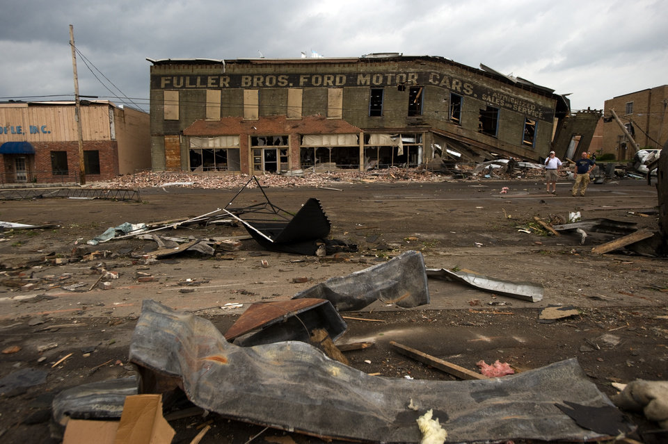 Photo - A commercial business building in downtown Cullman, Ala. crumbles after a tornado touched down on Wednesday afternoon, April 27, 2011. (AP Photo/Decatur Daily, Brennen Smith)