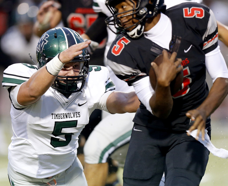 Norman North\'s Beau Proctor tries to tackle Westmoore\'s Jhames West during a high school football game in Moore, Okla., Thursday, September 13, 2012. Photo by Bryan Terry, The Oklahoman