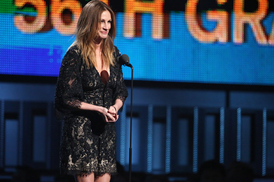 Photo - Julia Roberts speaks at the 56th annual Grammy Awards at Staples Center on Sunday, Jan. 26, 2014, in Los Angeles. (Photo by Matt Sayles/Invision/AP)