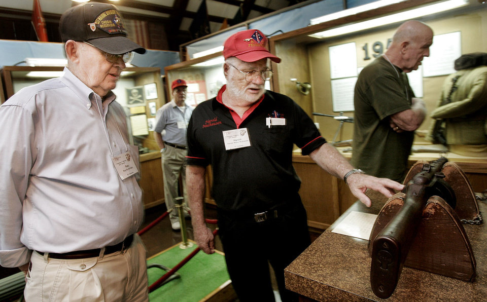 Left- Ron Burbridge of Kansas and Harold Mulhansen of Oklahoma discuss a burp gun in the Korean display area of the 45th Infantry Museum . Mulhansen organized the reunion ofThe 1st Battalion 7th Regiment of the U.S. Marines who fought in Korea and toured the museum Friday, Oct. 5, 2007 in Oklahoma City, OK. BY JACONNA AGUIRRE/THE OKLAHOMAN.