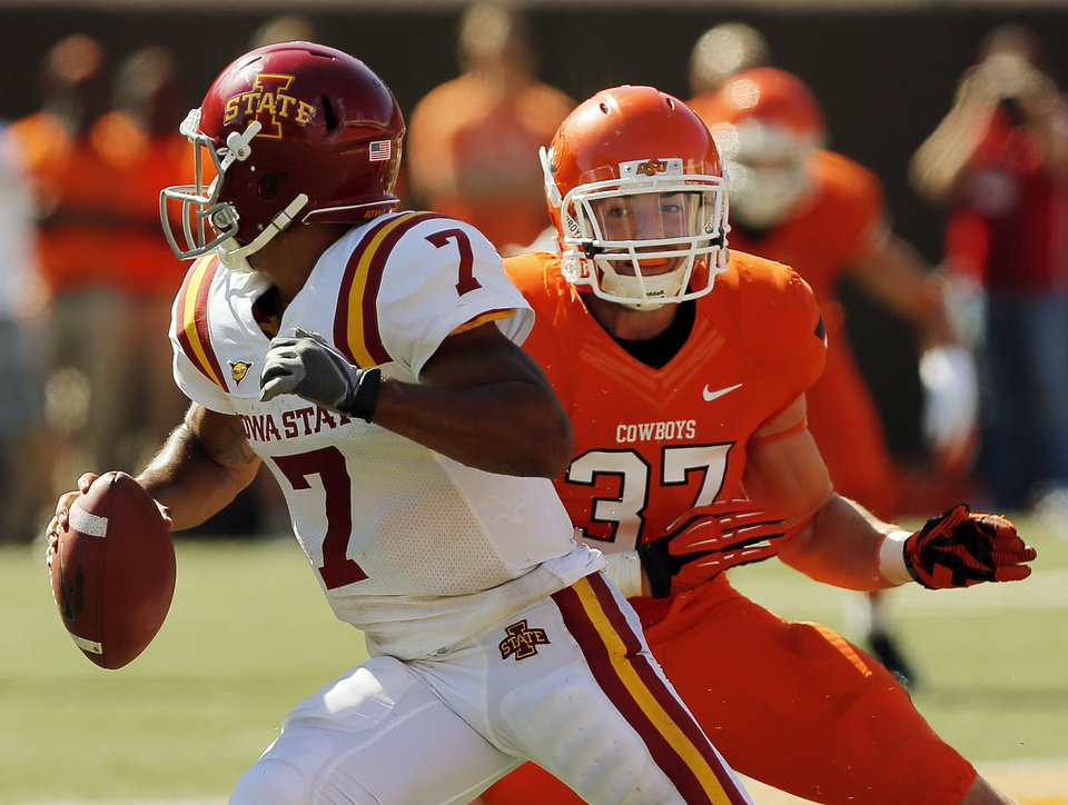 Photo - Oklahoma State's Alex Elkins (37) pressures Iowa State's Jared Barnett (7)  during a college football game between Oklahoma State University (OSU) and Iowa State University (ISU) at Boone Pickens Stadium in Stillwater, Okla., Saturday, Oct. 20, 2012. OSU won, 31-10. Photo by Nate Billings, The Oklahoman