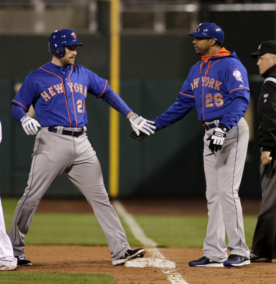 Photo - New York Mets' Daniel Murphy, left celebrates with first base coach Tom Goodwin (26) after hitting an RBI single against the Philadelphia Phillies in the third inning of a baseball game Tuesday, April 29, 2014, in Philadelphia. (AP Photo/H. Rumph Jr)