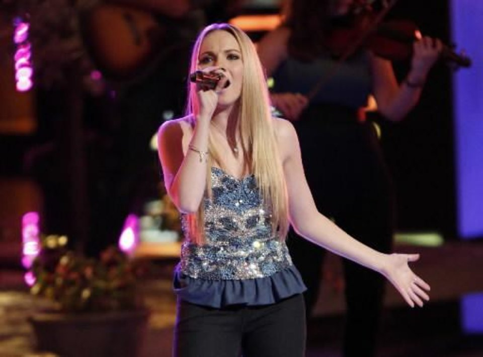 "Photo -  This June 17, 2013 photo released by NBC shows finalist Danielle Bradbery performing on the singing competition series ""The Voice,"" in Los Angeles. Bradbery won over Michelle Chamuel and Muskogee brother duo Zach and Colton Swon during the finale on Tuesday, June 18."