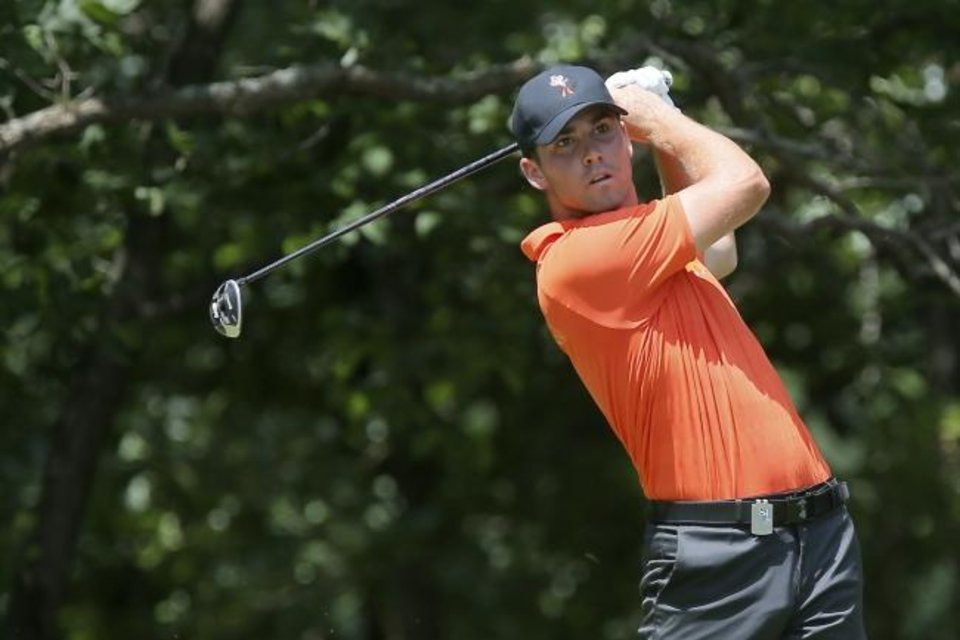 Photo -  Matthew Wolff, seen here during the 2018 NCAA Championships, had a big freshman season at Oklahoma State, but it's nothing compared to what he's done this spring. The sophomore not only broke the single-season school record for wins but also emerged as the biggest young star in golf. [BRYAN TERRY/THE OKLAHOMAN]