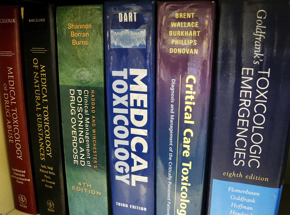 Photo - Shown are some of the reference materials in a bookcase  at the Oklahoma Poison Center in Oklahoma City.   Jim Beckel - THE OKLAHOMAN