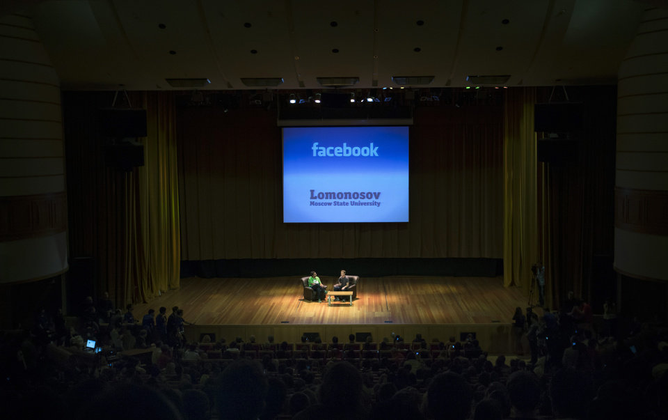 Photo -   FILE -In this Tuesday, Oct. 2, 2012, file photo, Facebook CEO Mark Zuckerberg, center, addresses students of Moscow's State University in Moscow, Russia. Facebook's third-quarter results released Tuesday, Oct. 23, 2012, inched past Wall Street's expectations, offering evidence that the company is making inroads in mobile advertising, a longtime concern among investors. (AP Photo/Alexander Zemlianichenko)