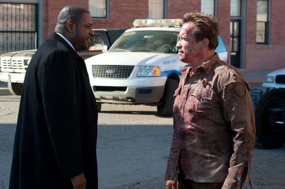 Photo - Forest Whitaker, left, and Arnold Schwarzennegger are shown in a scene from