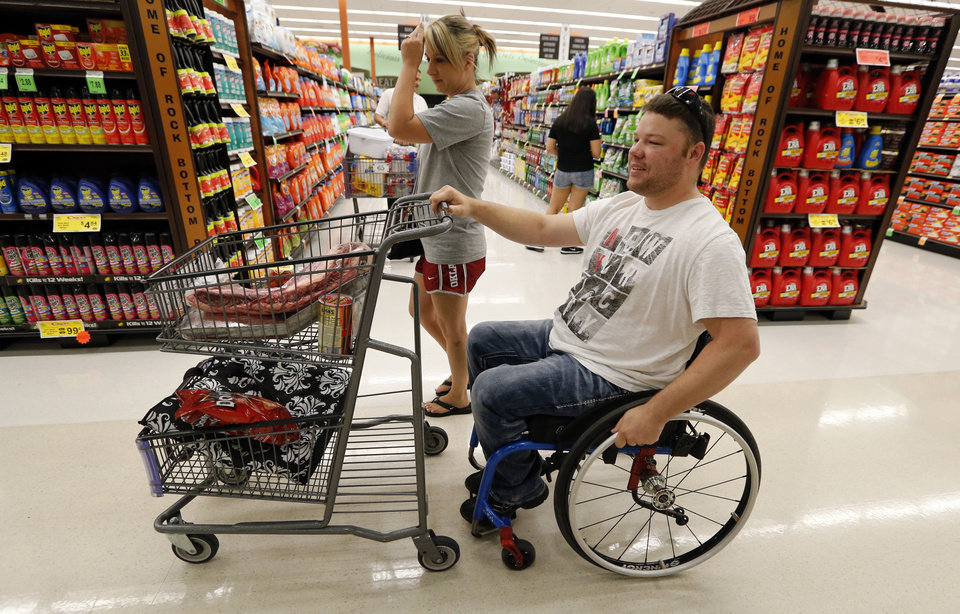 Photo -  EH Pittman and wife, Jean, shop at Crest Market in Norman. Pittman, who was injured in the Moore tornado, will be honored Friday with a Jim Thorpe Rehabilitation Award. Photo by Steve Sisney, The Oklahoman   STEVE SISNEY -  THE OKLAHOMAN