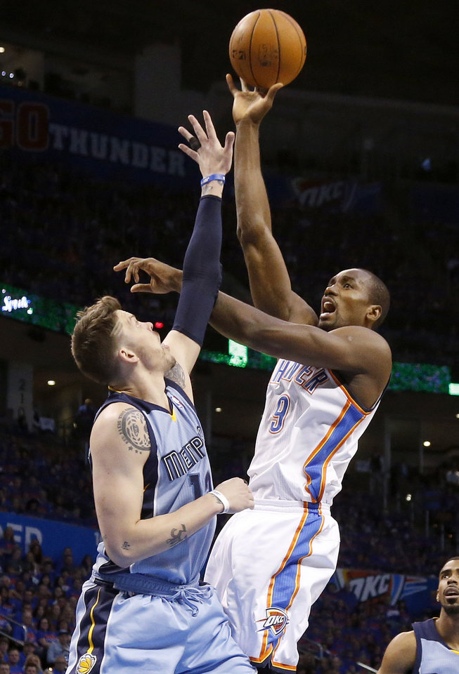Photo - Oklahoma City's Serge Ibaka (9) shoots over Memphis' Mike Miller (13) during Game 7 in the first round of the NBA playoffs between the Oklahoma City Thunder and the Memphis Grizzlies at Chesapeake Energy Arena in Oklahoma City, Saturday, May 3, 2014. Photo by Nate Billings, The Oklahoman