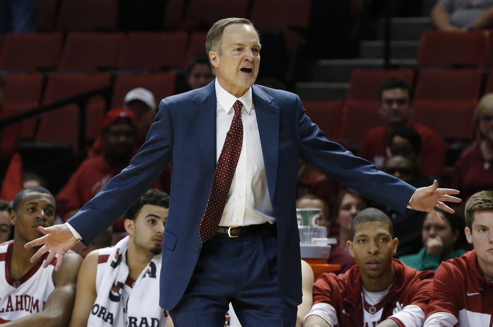 Photo - Oklahoma coach Lon Kruger gestures during the second half on an NCAA college basketball against Texas Tech in Norman, Okla., Wednesday, Feb. 12, 2014. Texas Tech won 68-60. (AP Photo/Sue Ogrocki)