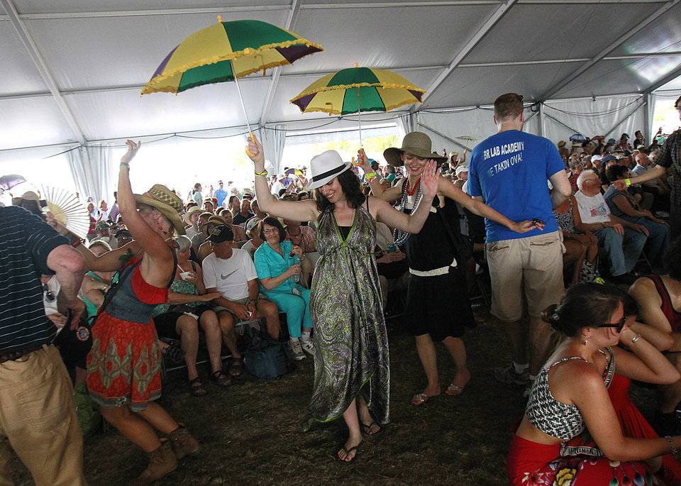 Photo -   Audience members dance in a second-line as the Preservation Hall Jazz Band performs inside the Economy Tent at the New Orleans Jazz and Heritage Festival in New Orleans, Saturday, May 5, 2012. (AP Photo/Gerald Herbert)