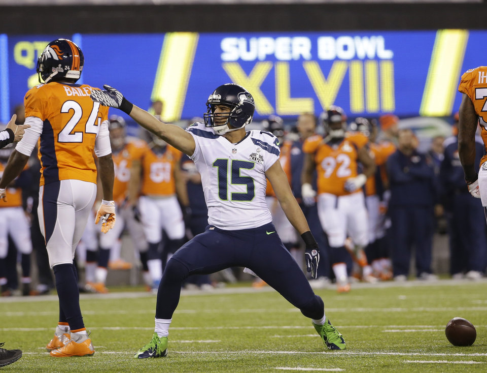 Photo - Seattle Seahawks' Jermaine Kearse (15) reacts to a first down during the first half of the NFL Super Bowl XLVIII football game against the Denver Broncos Sunday, Feb. 2, 2014, in East Rutherford, N.J. (AP Photo/Matt Slocum)