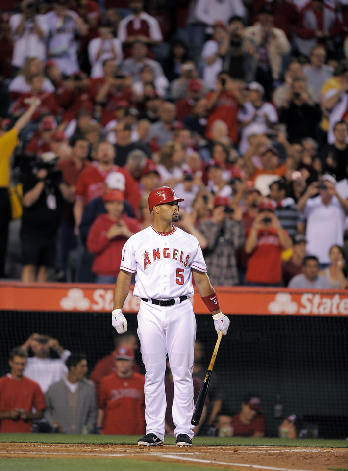 Los Angeles Angels' Albert Pujols gets set to bat during the first inning of a baseball game against the Kansas City Royals, Friday, April 6, 2012, in Anaheim, Calif. (AP Photo/Mark J. Terrill)