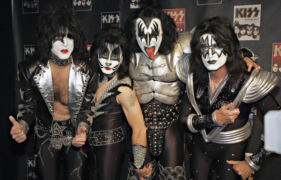 FILE - In this May 8, 2008 file photo, members of Kiss, from left, Paul Stanley, Eric Singer, Gene Simmons and Tommy Thayer, poses for a photograph during a news conference to promote the start of their KISS Alive/35 European Tour  in Oberhausen, Germany. This year it's Kiss that's angry with the Rock and Roll Hall of Fame, its members upset over the organization's decision only to induct original members Paul Stanley, Gene Simmons, Peter Criss and Ace Frehley while excluding members who joined later. As a result, the makeup-wearing rockers won't be wearing makeup or rocking at the ceremony Thursday, April 10, 2014, at the Barclays Center in Brooklyn, New York. (AP Photo/Volker Wiciok, file)