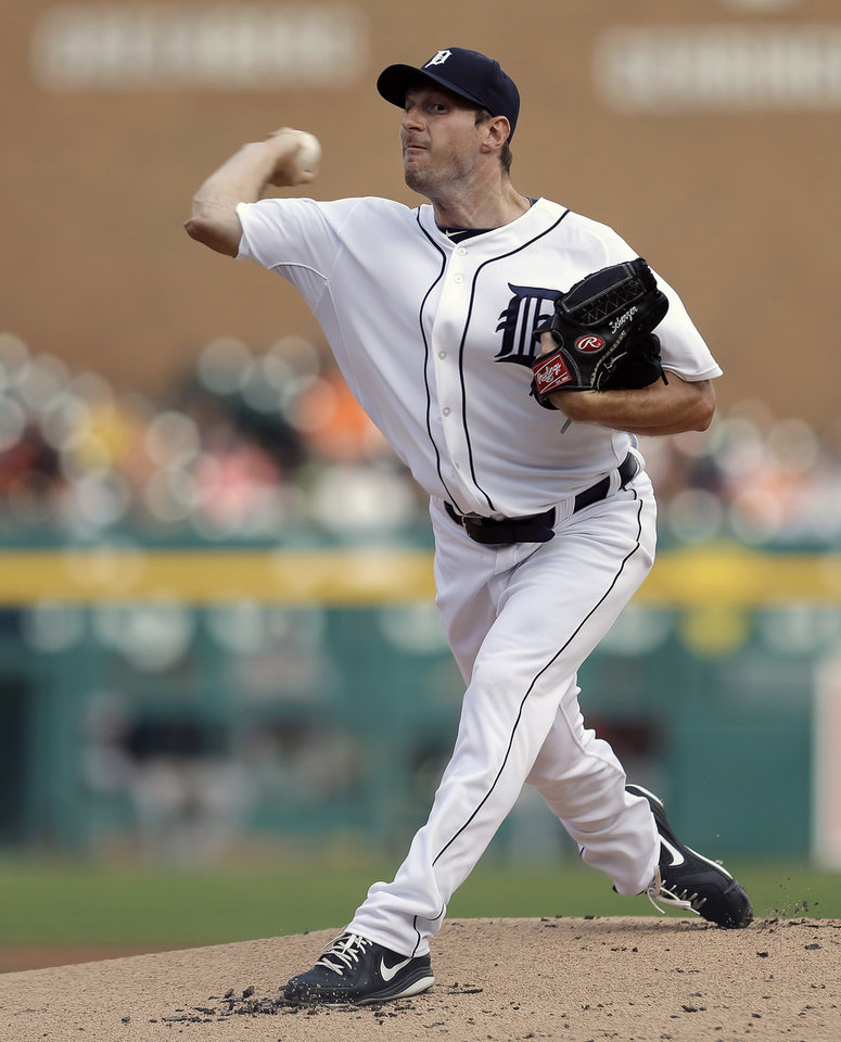 Photo - FILE - In this June 17, 2013, file photo, Detroit Tigers pitcher Max Scherzer throws to a Baltimore Orioles batter during a baseball game in Detroit. Scherzer won the American League Cy Young Award on Wednesday, Nov. 13, 2013. (AP Photo/Paul Sancya, File)