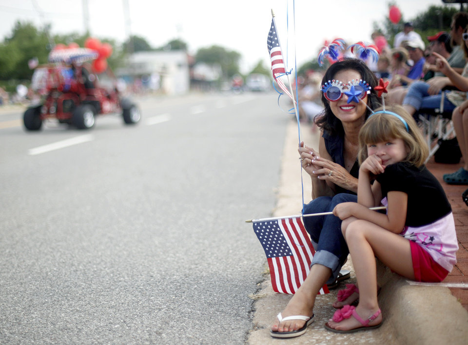 Photo - Rosie Satterlee watches the LibertyFest Parade with her grand daughter Monica Jane Heerema, 5, in Edmond, Okla., Monday, July 4, 2011. Photo by Sarah Phipps, The Oklahoman