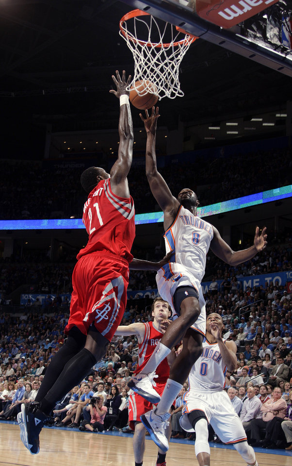 Photo - Oklahoma City's Nazr Mohammed (8) shoots over Houston's Samuel Dalembert (21)during the NBA basketball game between the Oklahoma City Thunder and the Houston Rockets at the Chesapeake Energy Arena, Tuesday, March 13, 2012. Photo by Sarah Phipps, The Oklahoman.