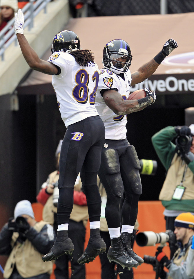 Photo -   Baltimore Ravens running back Bernard Pierce, right, celebrates his 12-yard touchdown run with wide receiver Torrey Smith in the first quarter of an NFL football game against the Cleveland Browns, Sunday, Nov. 4, 2012, in Cleveland. (AP Photo/Tony Dejak)