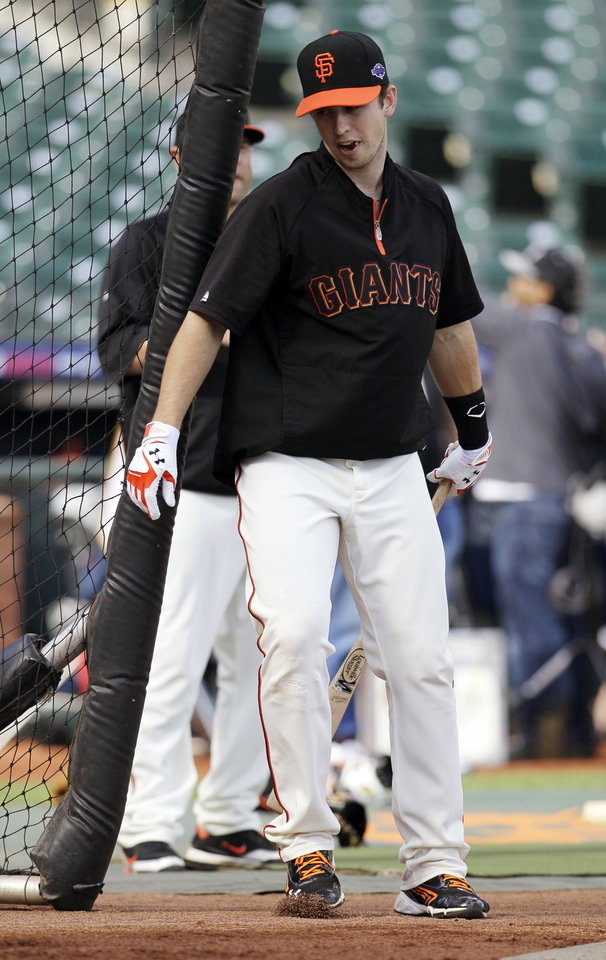 Photo -   San Francisco Giants' Buster Posey heads to the batting cage before Game 7 of baseball's National League championship series against the St. Louis Cardinals Monday, Oct. 22, 2012, in San Francisco. (AP Photo/Mark Humphrey)