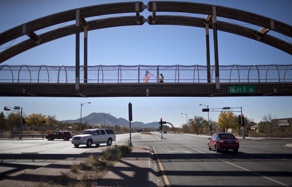 Photo -   Jessie Hyder, 69, waves a flag to remind drivers to vote on Tuesday, Nov. 6, 2012, over the intersection of Tramway and Copper in Albuquerque, N.M. Ryder, a Vietnam veteran said he wanted people to vote for freedom and that they have to follow their individual consciousness. (AP Photo/Craig Fritz)