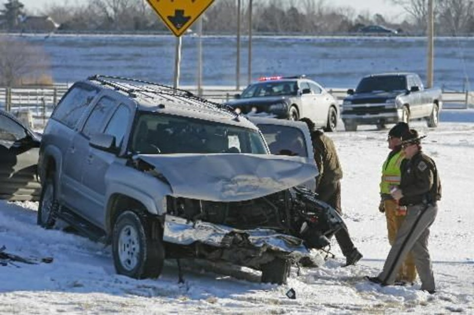 Photo - Only minor injuries were reported in a head-on collision on State Highway 74 two miles west of the Purcell on Thursday, February 10, 2011, in Purcell, Okla. A southbound Suburban slid on packed snow, crossed the center line and collided with a northbound pickup in the northbound lane. A third car following the Suburban slid into the Suburban after it came to rest on the side of the highway. Photo by Steve Sisney