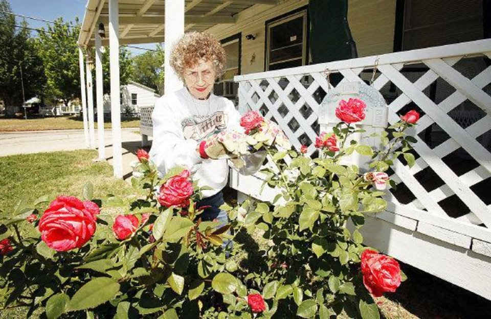 Photo - Homeowner Virginia Hay tends the flower garden at her home in the Riverpark Neighborhood in Oklahoma City, OK, Thursday, April 28, 2011. By Paul Hellstern, The Oklahoman ORG XMIT: KOD