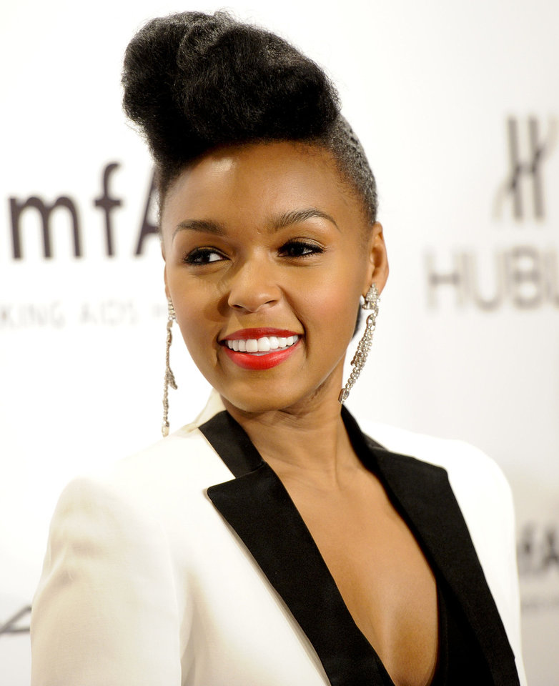 Photo - Singer Janelle Monae is known for her pompadour hairstyle.  Evan Agostini