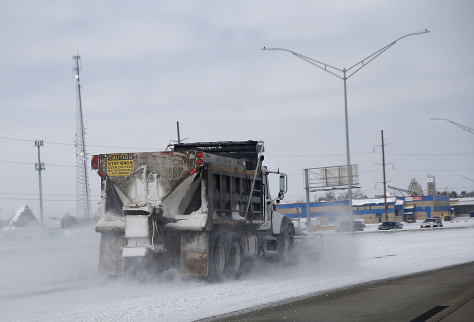 Photo - A snow plow clears the Broadway Extension in  Oklahoma City, Wednesday, Feb. 17, 2021. [Sarah Phipps/The Oklahoman]