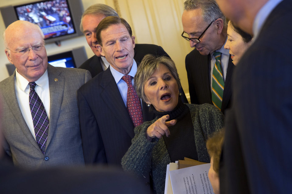 Photo - Senate Environment and Public Works Committee Chairman Sen. Barbara Boxer, D-Calif., talks with Senators during a meeting of the Senate Climate Action Task Force prior to taking to the Senate Floor all night to urge action on climate change on Monday, March 10, 2014, in Washington, from left, Sen. Patrick Leahy, D, Vt., Sen. Ed Markey, D-Mass., Richard Blumenthal, D- Conn., Sen. Chuck Schumer, D-N.Y., and Sen. Maria Cantwell, D-Wash. (AP Photo/ Evan Vucci)