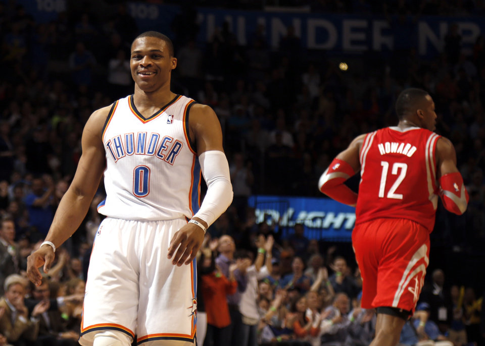 Photo - Oklahoma City's Russell Westbrook (0) reacts to a play during the NBA game between the Oklahoma City Thunder and Houston Rockets at the  Chesapeake Energy Arena  in Oklahoma City, Okla., Tuesday, March 11, 2014. Photo by Sarah Phipps, The Oklahoman