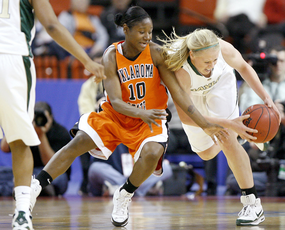 OSU's Andrea Riley and Baylor's Melissa Jones go for the ball during the Big 12 Women's Championship game between Oklahoma State and Baylor at the Cox Center in Oklahoma City, Friday, March 13, 2009.  PHOTO BY BRYAN TERRY, THE OKLAHOMAN