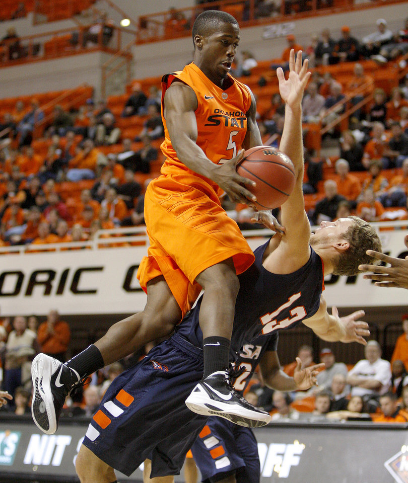 Oklahoma State's Reger Dowell (5) runs into Texas-San Antonio's Igor Nujic (13)during an NCAA college basketball game between the Oklahoma State University Cowboys (OSU) and the University of Texas-San Antonio Roadrunners at Gallagher-Iba Arena in Stillwater, Okla., Wednesday, Nov. 16, 2011. Photo by Bryan Terry, The Oklahoman