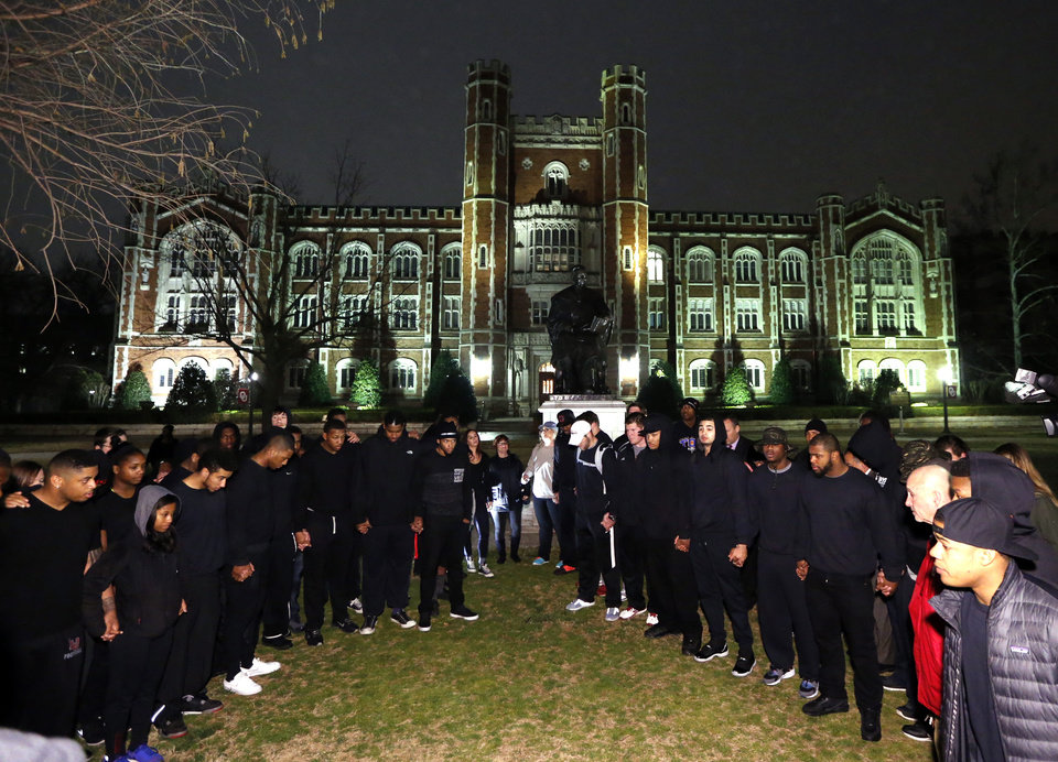 Photo - Student athletes at the University of Oklahoma form up to pray and protest racist comments made by a fraternity on March 9, 2015 in Norman, Okla. Photo by Steve Sisney, The Oklahoman
