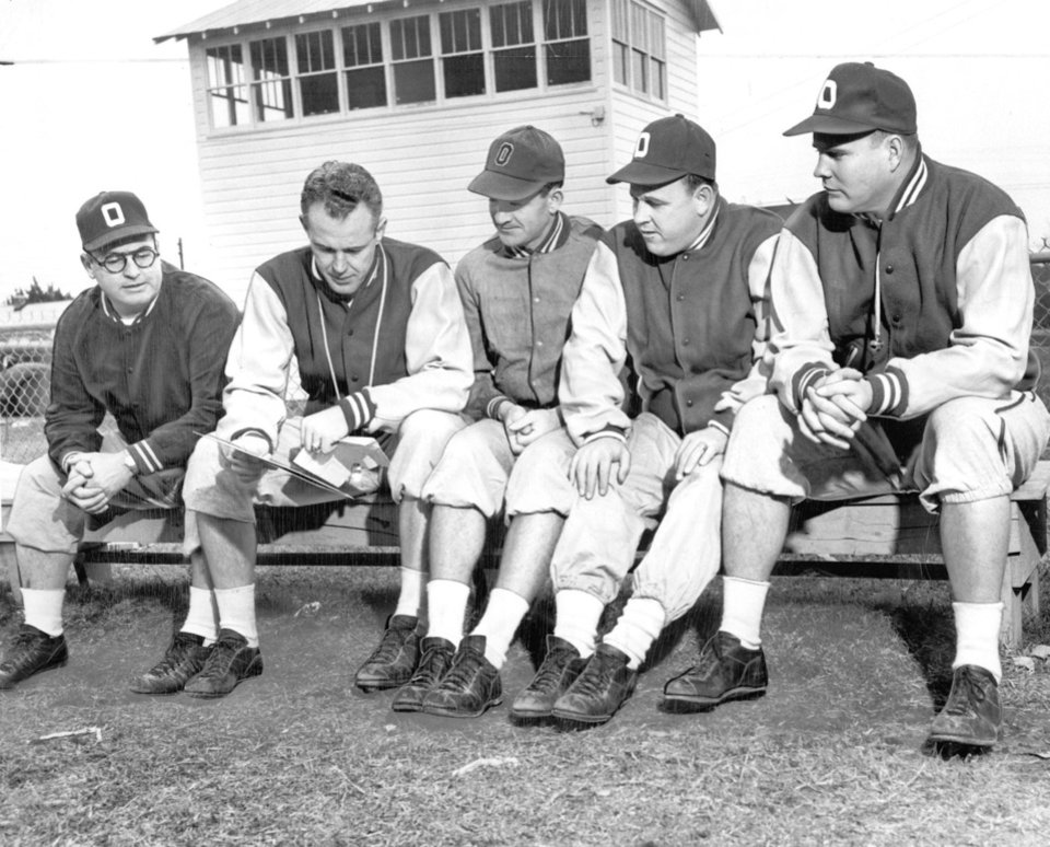 "Photo - OU, SUGAR BOWL: Oklahoma University's head college football coach Bud Wilkinson maps out practice plans with four of his assistants at the Big Red's Biloxi training base. From left to right are Orville Tuttle, Wilkinson, Bill Jennings, Gomer Gones and Frank ""Pop"" Ivy. (Original photo taken 12/28/50, ran 12/31/50 E)"