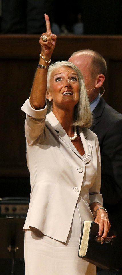 Photo -  Evangelist Anne Graham Lotz, daughter of renowned evangelist Billy Graham, shares a message of faith during the Church of God Convention on Tuesday at Crossings Community Church, 14600 N Portland in Oklahoma City. Photo by Bryan Terry, The Oklahoman   BRYAN TERRY -