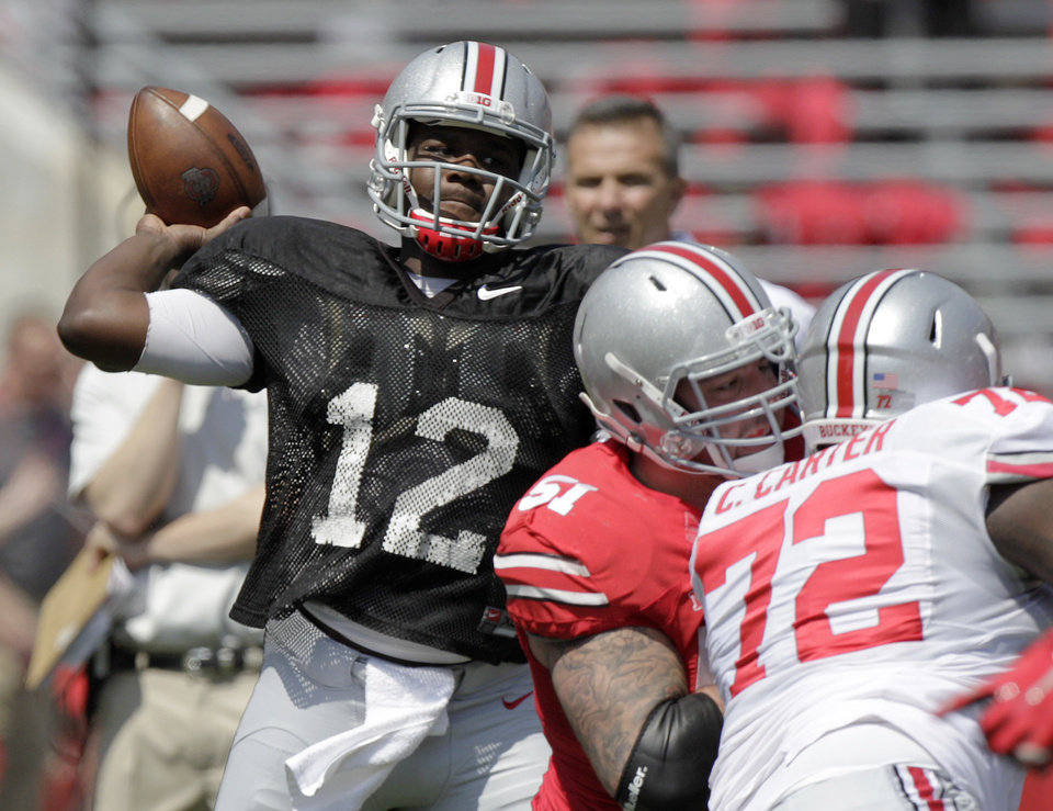 Photo - Ohio State quarterback Cardale Jones throws a pass during their spring NCAA college football game Saturday, April 12, 2014, in Columbus, Ohio. (AP Photo/Jay LaPrete)