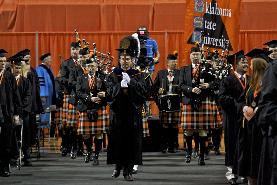 The Oklahoma State University Pipe and Drum band leads the graduates into the seating area at the Oklahoma State University morning graduation held in Gallagher Iba Arena in Stillwater, Oklahoma on May 5th, 2012. Photos by Mitchell Alcala for the Oklahoman