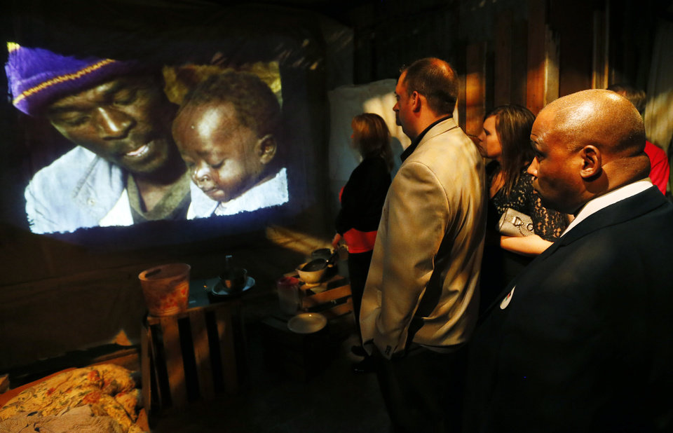 "People watch a film about the conditions in the slums of Kenya during the opening of the ""Story of Hope"" exhibit by Feed the Children at 4529 Enterprise Pl. in Oklahoma City, Thursday, May 16, 2013. Photo by Nate Billings, The Oklahoman"