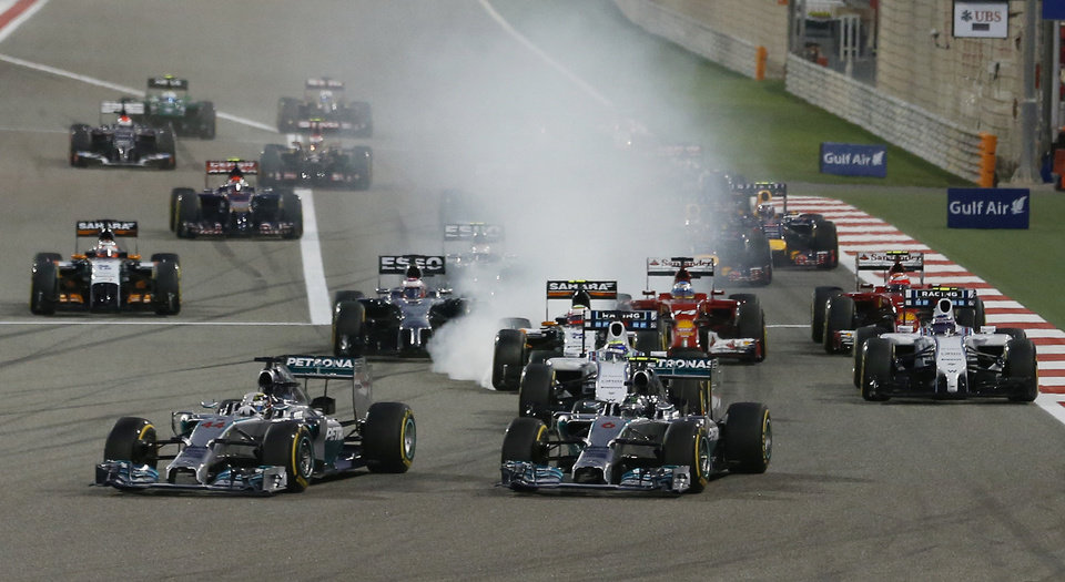 Photo - Mercedes driver Nico Rosberg of Germany leads the field after the start during the Bahrain Formula One Grand Prix at the Formula One Bahrain International Circuit in Sakhir, Bahrain, Sunday, April 6, 2014. (AP Photo/Hassan Ammar)