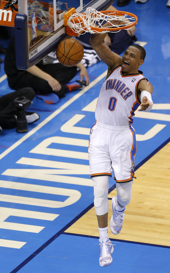 Photo - Oklahoma City's Russell Westbrook (0) dunks during Game 4 of the Western Conference Finals in the NBA playoffs between the Oklahoma City Thunder and the San Antonio Spurs at Chesapeake Energy Arena in Oklahoma City, Tuesday, May 27, 2014. Photo by Bryan Terry, The Oklahoman