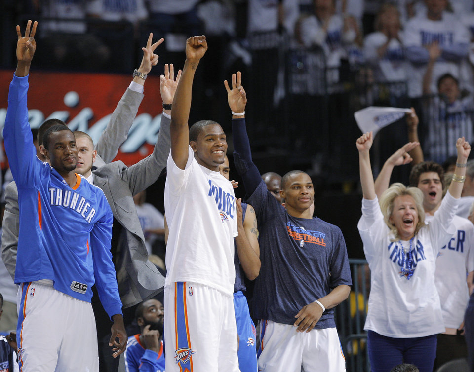 Photo - Oklahoma City's Serge Ibaka (9), Kevin Durant (35), and Russell Westbrook (0) celebrate during game five of the Western Conference semifinals between the Memphis Grizzlies and the Oklahoma City Thunder in the NBA basketball playoffs at Oklahoma City Arena in Oklahoma City, Wednesday, May 11, 2011. Photo by Bryan Terry, The Oklahoman