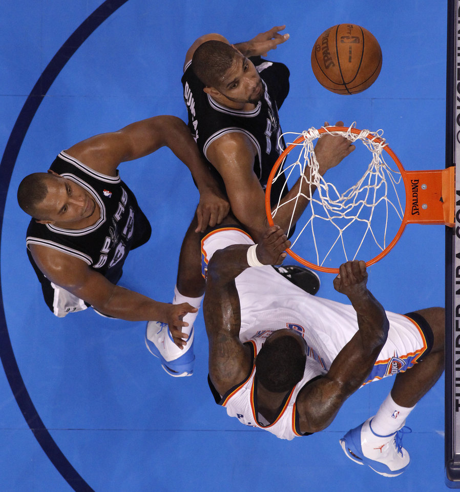 Photo - Oklahoma City's Kendrick Perkins (5) dunks the ball over San Antonio's Boris Diaw (33) and San Antonio's Tim Duncan (21) during Game 4 of the Western Conference Finals between the Oklahoma City Thunder and the San Antonio Spurs in the NBA playoffs at the Chesapeake Energy Arena in Oklahoma City, Saturday, May 31, 2012. Photo by Bryan Terry, The Oklahoman